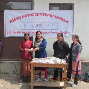 Distributing villager's women some health's supply in Jordi village center.